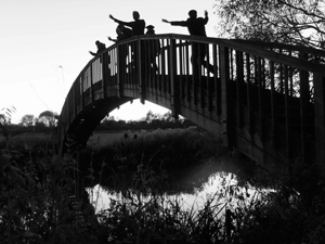 Picture of singing men dancing on a bridge on one of our outings.